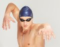 Man in swimming cap young athletic and googles Stock Photos