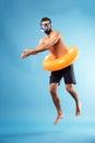 Man with swimming circle diving Royalty Free Stock Photo
