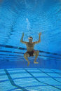 Man in swimming pool underwater view Royalty Free Stock Image