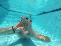 A man swimming under water with hands in front of him Stock Photography