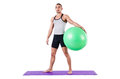 Man with swiss ball doing exercises on white Royalty Free Stock Photography