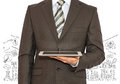 Man with tablet in hand and business sketches Royalty Free Stock Photo