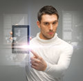 Man with tablet pc and virtual screens picture of Stock Photos
