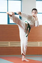 Man at taekwondo exercises Stock Photos