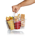 Man takes the shopping basket with food various on white Royalty Free Stock Photos