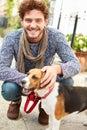 Man Taking Dog For Walk On City Street Royalty Free Stock Photo