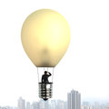 Man taking glowing lamp balloon floating over city building
