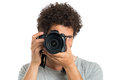 Man taking photo with camera young picture digital isolated on white background Royalty Free Stock Photo