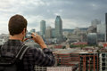 Man taking a picture of downtown montreal from high point view during beautiful cloudy day Royalty Free Stock Photography