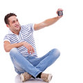 Man taking a picture of him self with phone Stock Photography