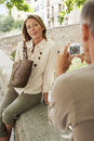 Man taking picture of woman on wall women in granada spain Stock Images