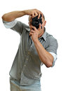 Man taking pictures with retro camera Royalty Free Stock Image