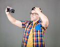 Man taking selfie isolated on gray background Royalty Free Stock Photo