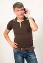 Man talking on cell phone sale and service of mobile phones Stock Image