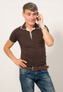 Man talking on cell phone sale and service of mobile phones Royalty Free Stock Image