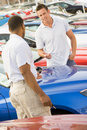 Man talking to car salesman Royalty Free Stock Photo