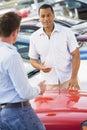 Man talking to car salesman Stock Image