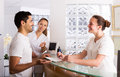 Man talks with nurses smiling men positive in the medical office Stock Photo
