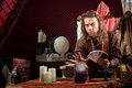 Man with tarot cards male fortune teller waving hand over crystal ball Stock Photo