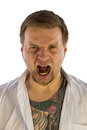 Man with tattooes screaming tatooes isolated photo portrait Royalty Free Stock Image