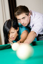 Man teaching lady to play billiards spending free time on gambling Royalty Free Stock Image