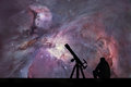 Man with telescope looking at the stars. The Orion Nebula