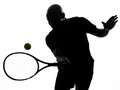 Man tennis player forehand silhouette african afro american playing on studio isolated on white background Stock Photos