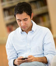 Man texting in the library Royalty Free Stock Image