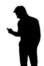 Man texting with one hand in silhouette isolated over white background Stock Photos