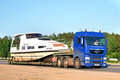 Man tgx chelyabinsk region russia june blue boat transporting truck at the interurban road Stock Photo