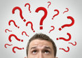 Man thinking concept with question marks Royalty Free Stock Photo