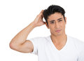 Man thinking scratching head Royalty Free Stock Photography