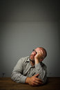 Man in thoughts dreamer sitting the shadow Royalty Free Stock Photography