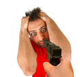 Man threatened with a gun on white background Royalty Free Stock Photos