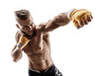 Man throwing a fierce and powerful punch Royalty Free Stock Photo