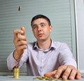 Man throwing up a coin Stock Image