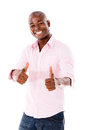 Man with thumbs up looking very happy isolated over white Stock Photography