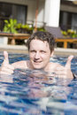 Man with thumbs up in pool Royalty Free Stock Photos