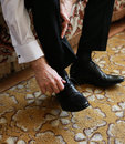 Man ties his shoes tying shoe lace shiney new black leather business Stock Images