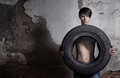 Man with tire Stock Photography