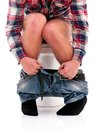 Man on toilet bowl Royalty Free Stock Photo