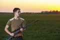 Man took aim with your sniper rifle young about rural roads Royalty Free Stock Photography