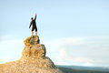 Man on top of mountain conceptual scene Royalty Free Stock Images