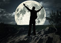 Man on the top of mountain looking at the moon standing Royalty Free Stock Photo