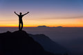 Man on top of the mountain looking to the sunrise Royalty Free Stock Photo