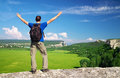 Man on top of mountain tourism concept tourist the high rock Royalty Free Stock Images