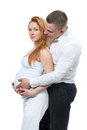 Man touching belly of his pregnant woman wife portrait young happy men women isolated on a white background Royalty Free Stock Image