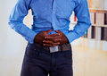 Man touching with hands his stomach normally people do this when they have pain Stock Image