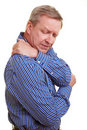 Man touching his aching shoulder Stock Image