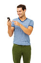 Man touching smart phone over white background happy young while standing vertical shot Stock Image